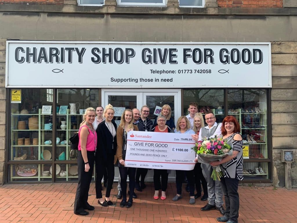 Employees from DSR Tax Refunds Ltd present staff at Give for Good with a cheque
